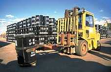 forklift stacking yellowcake drums